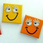 Smiley Magnete in den Farben rot, gelb und orange
