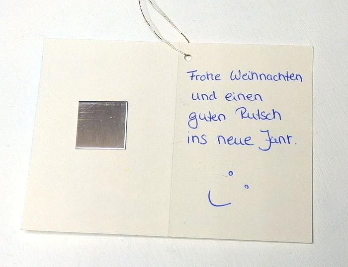 Weihnachtskarte von innen beklebt mit einem Metallplättchen