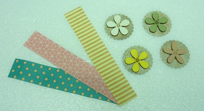 Papierstreifen und Stanzteile beklebt mit Blume aus Holz