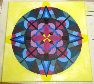 Mandala ausgemalt mit Acrylfarbe vor dem Umranden